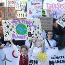 20/9/2019, Evie Cahill, aged 8, a student at Loreto, St Stephens Green takes part in a climate change march at Merrion Square in Dublin. Picture credit; Damien Eagers / INM