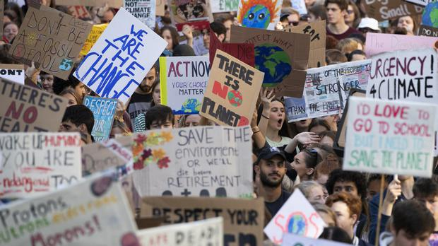 Youngsters march through the city centre at the UK Student Climate Network's Global Climate Strike in Edinburgh (Jane Barlow/PA)