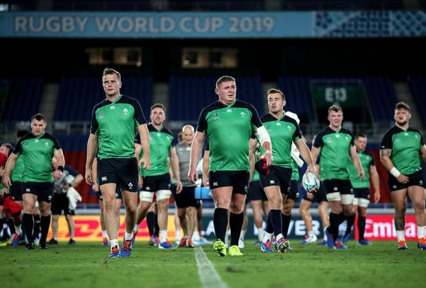 Jack Carty and Tadhg Furlong lead the players off the pitch after yesterday's Captain's Run in Yokohama. Photo: ©INPHO/Dan Sheridan