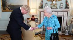 Royal welcome: Queen Elizabeth II greets British Prime Minister Boris Johnson at Buckingham Palace. Picture: AFP/Getty