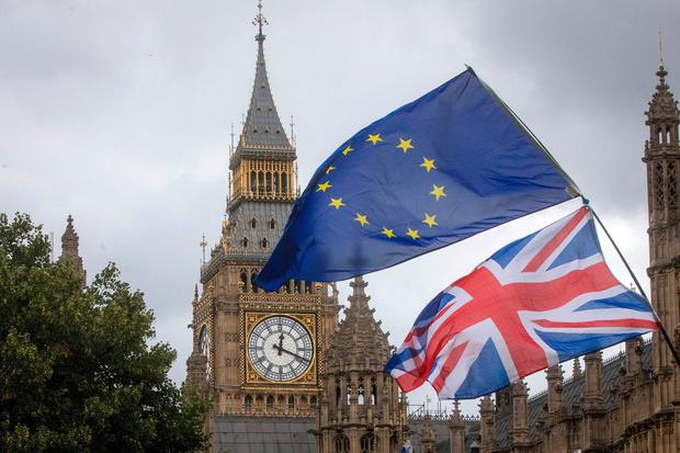 Wave of uncertainty: A Union flag and an EU flag outside the Houses of Parliament. Photographer: Simon Dawson/Bloomberg