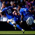 James Maddison of Leicester City (L) celebrates as he scores his team's second goal with Demarai Gray during the Premier League match between Leicester City and Tottenham Hotspur at The King Power Stadium (Photo by Laurence Griffiths/Getty Images)