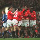 4 MAR 1995: PAUL INCE OF MANCHESTER UNITED IS CONGRATULATED BY HIS TEAM MATES AFTER SCORING FOR MAN UTD DURING THEIR 9-0 VICTORY OVER IPSWICH TOWN IN THE FA PREMIERSHIP MATCH AT OLD TRAFFORD, MANCHESTER. Mandatory Credit: Anton Want/ALLSPORT