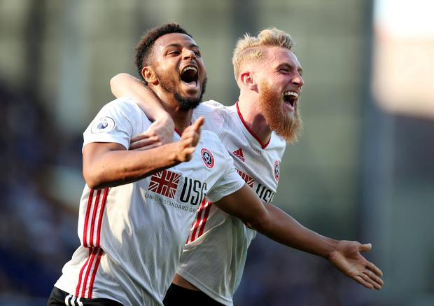 Sheffield United's Lys Mousset celebrates scoring their second goal with Oliver McBurnie. Photo: Chris Radburn/Reuters