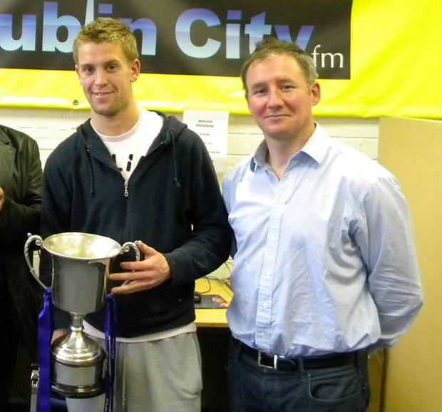 Jonny Cooper with the All-Ireland U21 (Clarke) Cup alongside manager Jim Gavin