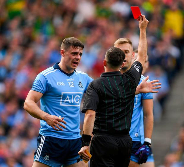 Jonny Cooper receiving a red card from referee David Gough in the All-Ireland final. Photo: Ramsey Cardy/Sportsfile