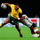 Samu Kerevi of Australia is tackled by Dominiko Waqaniburotu of Fiji. Photo: Getty Images