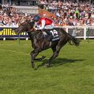 Angel Alexander, ridden by Richard Kingscote, wins the Ayr Gold Cup. Photo: John Grossick