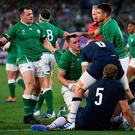 Ireland's lock James Ryan (C) is congratulated after scoring a try during the Japan 2019 Rugby World Cup Pool A match between Ireland and Scotland at the International Stadium Yokohama in Yokohama on September 22, 2019. (Photo by CHARLY TRIBALLEAU / AFP)CHARLY TRIBALLEAU/AFP/Getty Images
