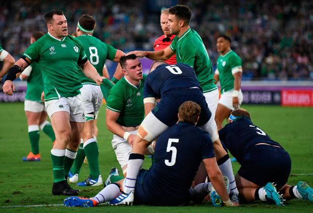 Irish defender James Ryan (C) congratulates after trying during the 2019 Rugby World Cup pool for Japan in the match between Ireland and Scotland at Yokohama International Stadium in Yokohama on September 22, 2019. (Photo by CHARLY TRIBALLEAU / AFP) CHARLY TRIBALLEAU / AFP / Getty pictures