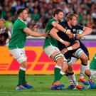 Scotland's Jonny Gray is tackled by Ireland's Iain Henderson during the 2019 Rugby World Cup Pool A match at the International Stadium Yokohama, Yokohama City. Ashley Western/PA Wire.