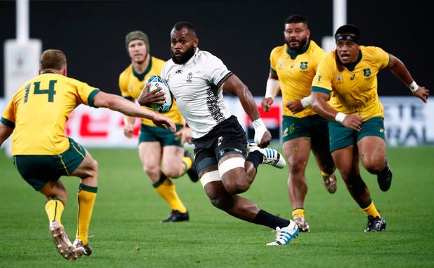Rugby Union - Rugby World Cup 2019 - Pool D - Australia v Fiji - Sapporo Dome, Sapporo, Japan - September 21, 2019 Fiji's Peceli Yato in action with Australia's Reece Hodge REUTERS/Edgar Su