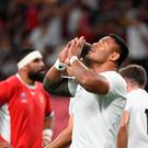 England's centre Manu Tuilagi celebrates after scoring a try during the Japan 2019 Rugby World Cup Pool C match between England and Tonga at the Sapporo Dome in Sapporo on September 22, 2019. (Photo by WILLIAM WEST / AFP)WILLIAM WEST/AFP/Getty Images