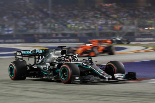 Mercedes driver Lewis Hamilton of Britain steers his car during the Singapore Formula One Grand Prix, at the Marina Bay City Circuit in Singapore