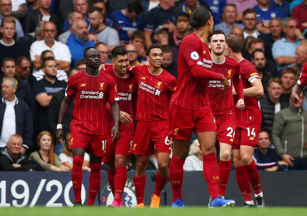 Liverpool's Roberto Firmino celebrates scoring their second goal against Chelsea with Trent Alexander-Arnold and team-mates. Photo: Reuters/Eddie Keogh