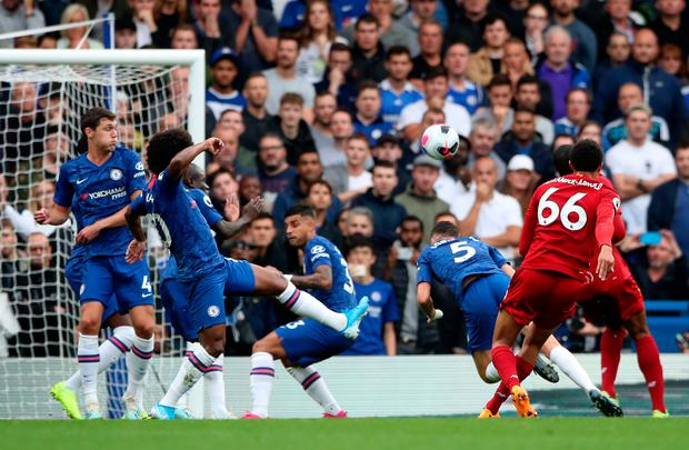 Liverpool's Trent Alexander-Arnold scores his side's first goal of the game during the Premier League match at Stamford Bridge, London.
