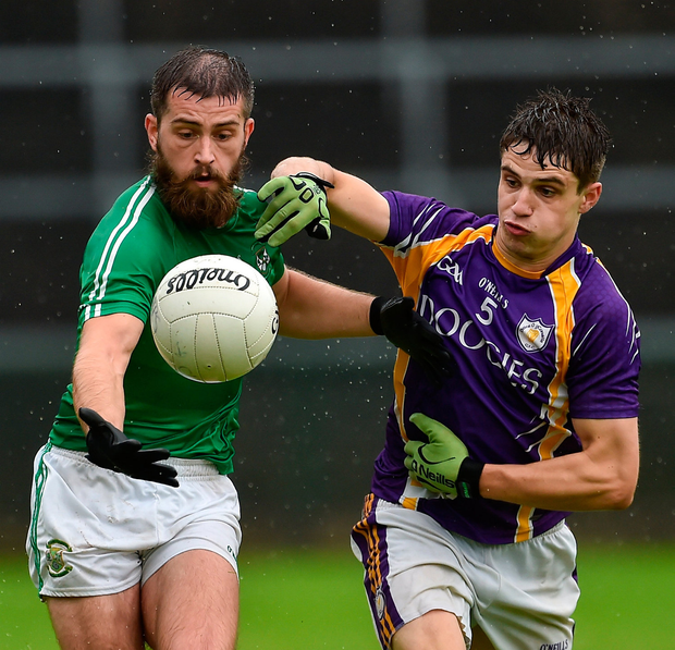 Conor Mulligan of Roslea Shamrocks in action against Lee Jones of Derrygonnelly Harps. Photo by Oliver McVeigh/Sportsfile