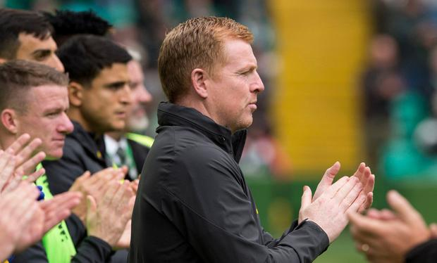 Celtic manager Neil Lennon takes part in a minute's applause as a tribute to former Rangers player Fernando Ricksen at Celtic Park, Glasgow. PA Photo