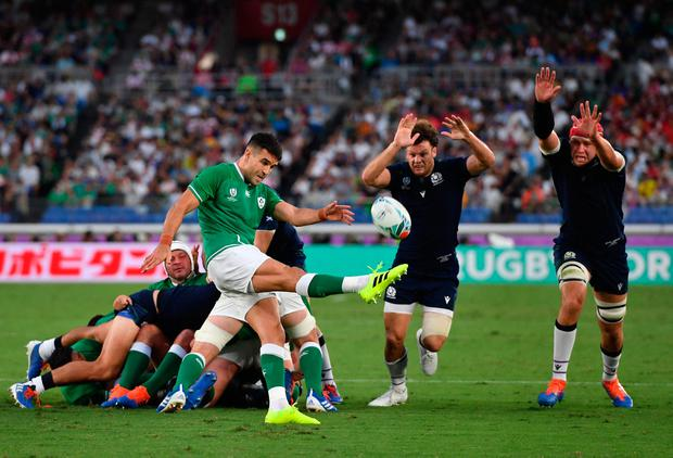 On top of his game: Conor Murray clears from Scotland's Duncan Taylor and Grant Gilchrist during yesterday's clash in Yokohama Photo: Ashley Western/PA Wire.