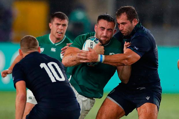 Ireland's back row Jack Conan (2nd R) is tackled. Photo: Getty Images