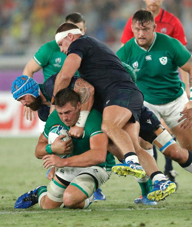 Ireland player CJ Stander is tackled by Blade Thomson (l) and Allan Dell. Photo by Stu Forster/Getty Images