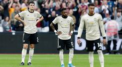 Looking lost in London: Harry Maguire, Fred and Jesse Lingard can't hide their disappointment after Manchester United's defeat to West Ham at the London Stadium. Photo: Henry Browne/Getty Images
