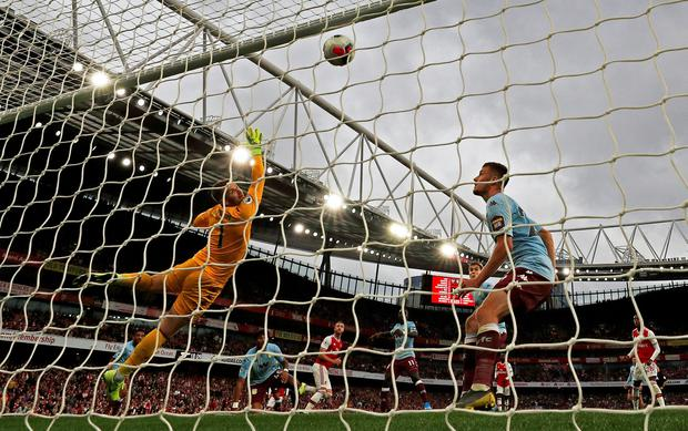 Arsenal's Calum Chambers scores their equaliser against Villa at the Emirates. Photo: REUTERS/Hannah McKay