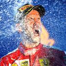 Ferrari's Sebastian Vettel celebrates after ending his year-long wait for a Grand Prix victory. Photo: Clive Mason/Getty Images