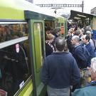 Timing: Passengers boarding a crowded Dart at Tara Street station. Photo: Ronan Lang