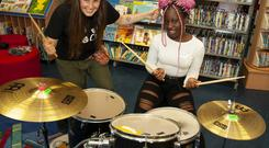 Drumming up interest: Girls Rock Dublin volunteer Aileen Wallace with Promise, launching the Dublin City Libraries and Girls Rock Dublin GRD Gear Library, the loan service designed for teenagers. Photo: Fennell Photography