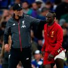 Jurgen Klopp celebrates victory with Sadio Mane, who suffered an injury against Chelsea