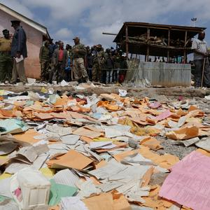 People look on after the Precious Talent Top School building collapsed in Kenya's capital, Nairobi, leaving many dead and injured, Monday, Sept. 23, 2019. Officials said at least seven are dead and many others are injured, some in critical condition, taken to hospital after the school building collapsed in Nairobi. (AP Photo/Khalil Senosi)