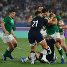 Jacob Stockdale of Ireland is tackled by Scotland players, from left, Ali Price, Darcy Graham and Stuart Hogg during the 2019 Rugby World Cup Pool A match between Ireland and Scotland at the International Stadium in Yokohama, Japan. Photo by Ramsey Cardy/Sportsfile