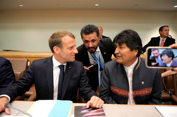 French President Emmanuel Macron (L) sits with Bolivian President Evo Morales during a meeting on the Amazon, on the sidelines of the UN General Assembly in New York. Photo by Ludovic Marin/AFP
