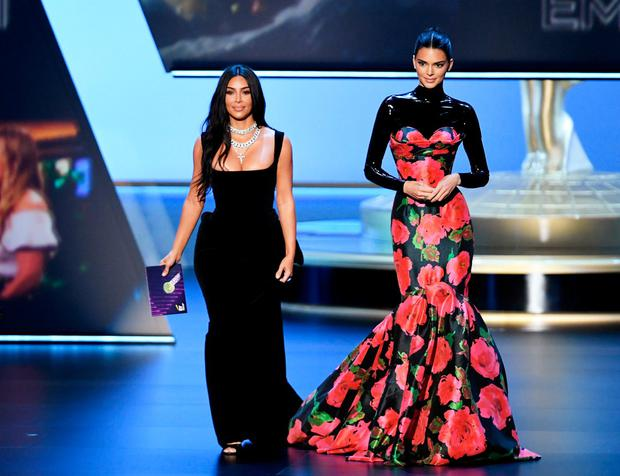 Coming up roses: Kendall Jenner accessorised Richard Quinn's rose-festooned mermaid gown with a black latex polo-neck. Photo: Kevin Winter/Getty Images