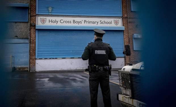 A policeman at Holy Cross Primary School in Belfast. Photo: Kevin Scott