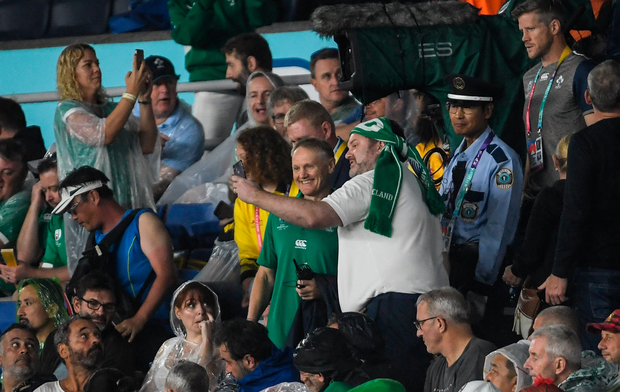 Ireland head coach Joe Schmidt has his photo taken with a supporter during the Rugby World Cup match against Scotland at the International Stadium in Yokohama