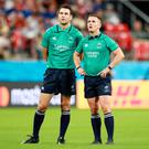 Match officials Ben O'Keeffe and Luke Pearce look at the big screen