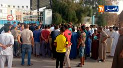 People standing outside the maternity unit of a hospital in Oued Sou Photo by STRINGER / various sources / AFP