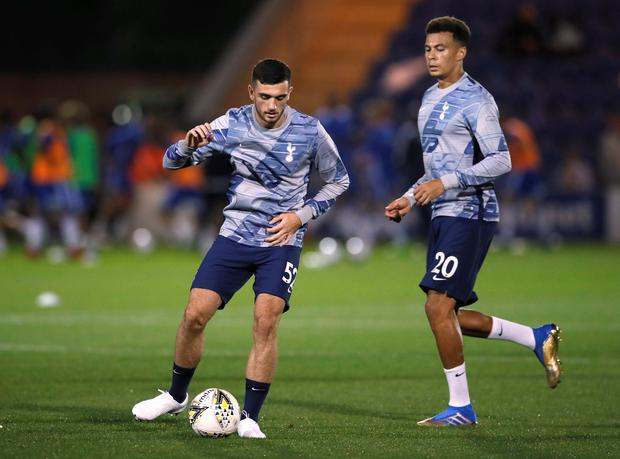 Tottenham Hotspur's Troy Parrott warms up with team-mate Dele Alli before the Carabao Cup third round clash against Colchester United at the JobServe Community Stadium.