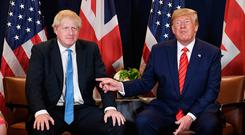 Jovial mood: British Prime Minister Boris Johnson meets US President Donald Trump at the UN, before the impeachment move was announced. Picture: PA