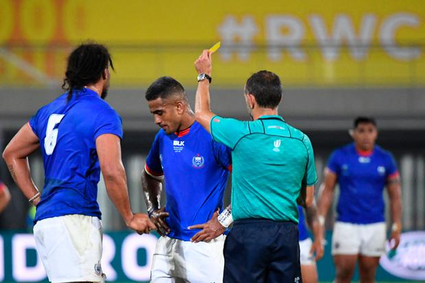 Samoa's centre Rey Lee-Lo (centre) receives a yellow card from French referee Romain Poite (right) during the 2019 Rugby World Cup Pool A win over Russia at the Kumagaya Rugby Stadium in Kumagaya. Photo: William West/Getty Images