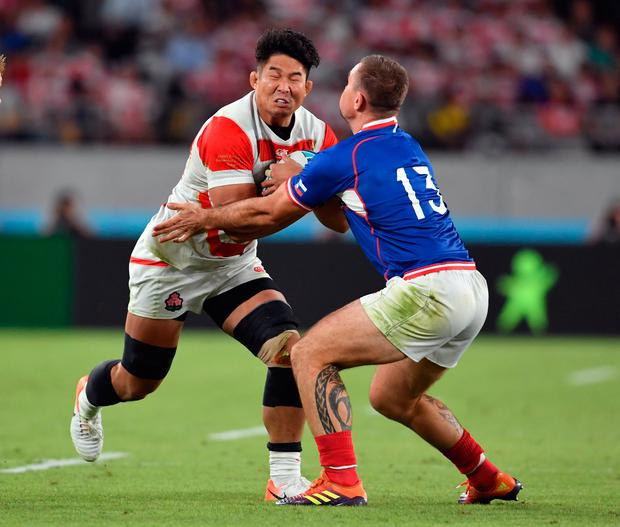 Japan's Kazuki Himeno is tackled by Russia's Vladimir Ostroushko during the Pool A match between Japan and Russia at the Tokyo Stadium, last Friday. Photo: Ashley Western/PA Wire