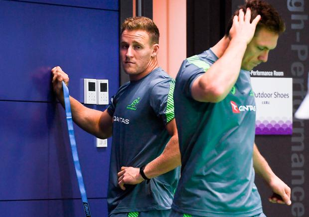 Australia's full back Reece Hodge (left) takes part in a gym training session in Tokyo. Photo: William West/Getty Images