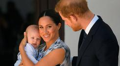 Prince Harry, Duke of Sussex and Meghan, Duchess of Sussex and their baby son Archie Mountbatten-Windsor at a meeting with Archbishop Desmond Tutu at the Desmond & Leah Tutu Legacy Foundation during their royal tour of South Africa on September 25, 2019 in Cape Town, South Africa. (Photo by Toby Melville - Pool/Getty Images)