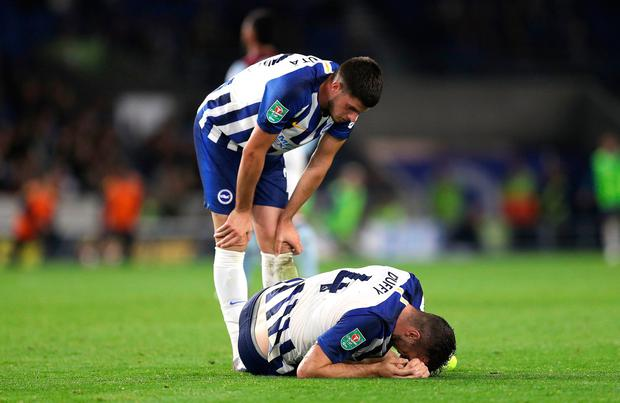 Brighton and Hove Albion's Shane Duffy (right) appears injured during the Carabao Cup, Third Round match at the AMEX Stadium, Brighton. Andrew Matthews/PA Wire.