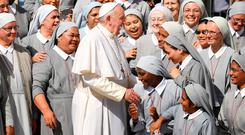 Working the crowd: Pope Francis is greeted by nuns during his weekly general audience in the Vatican's St Peter's Square yesterday. Photo: ALBERTO PIZZOLI/AFP/Getty Images