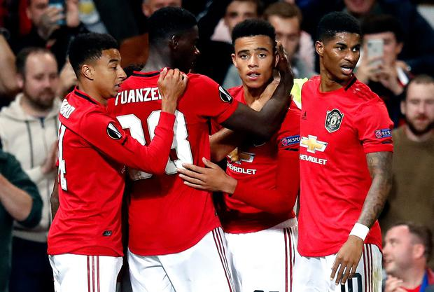 Manchester United's Mason Greenwood (third left) celebrates scoring his sides first goal of the game with teammates during the UEFA Europa League Group L match at Old Trafford, Manchester. Martin Rickett/PA Wire