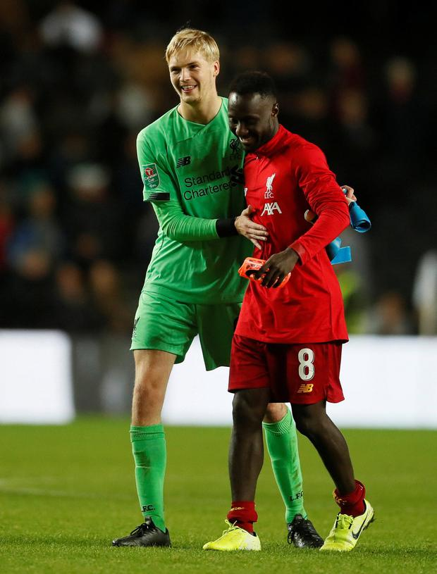 Liverpool's Caoimhin Kelleher and Naby Keita celebrate after the match