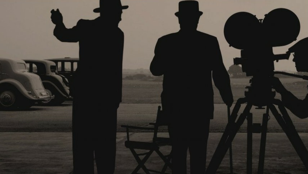 Alexander Korda and the unmistakeable, even in silhouette, Winston Churchill, pictured at Korda's movie studio